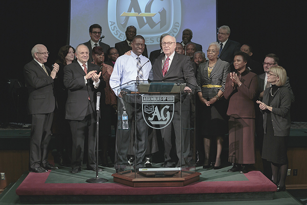 Center, Rev. Thomas Barclay and Dr. George O. Wood stand together when the Pentecostal organizations unite after nearly 100 years apart. Photo courtesy of Jorge Tobar