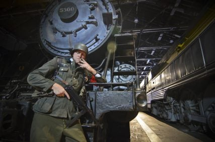 """A Nazi soldier stands near a train in a scene from the film """"Enemy of the Reich: The Noor Inayat Khan Story."""" For use with RNS-REICH-FILM, transmitted on February 24, 2014, Photo courtesy of Unity Productions Foundation"""