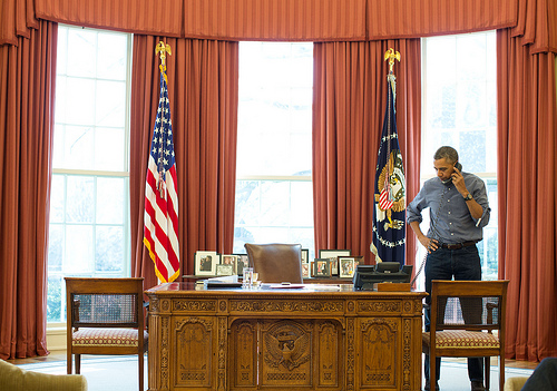 President Barack Obama talks on the phone in the Oval Office with Russian President Vladimir Putin about the situation in Ukraine on March 1, 2014. (Official White House Photo by Pete Souza)