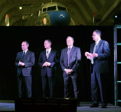 Left to right, CFO Randy Boushek, managing partner Dan Nickodemus, chairman of the board Dick Moeller, and CEO Brad Hewitt address the crowd during Thrivent's  regional members meeting at the Henry Ford Museum on March 13. Photo by David Yonke/Toledo Faith & Values
