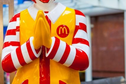 A Ronald McDonald statue in front of a Mcdonald's restaurant in Bangkok ,Thailand.