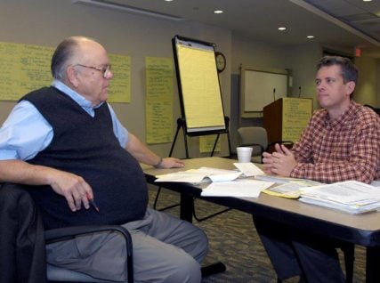 Alban Consultant Ed White, left, and David Pratt, a former Alban Director of Marketing, work during a meeting. Photo courtesy of West End Strategy Team
