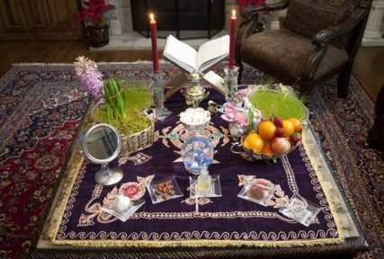 "One of the most important traditions carried out during Naw-Ruz is the ""Haft Seen Table,"" or ""Table of Seven S's,"" decorated with items symbolizing spring. Pictured here is a Haft Seen Table prepared by a Persian-American family in Overland Park, Kan., in preparation for the holiday. RNS photo by Sally Morrow"