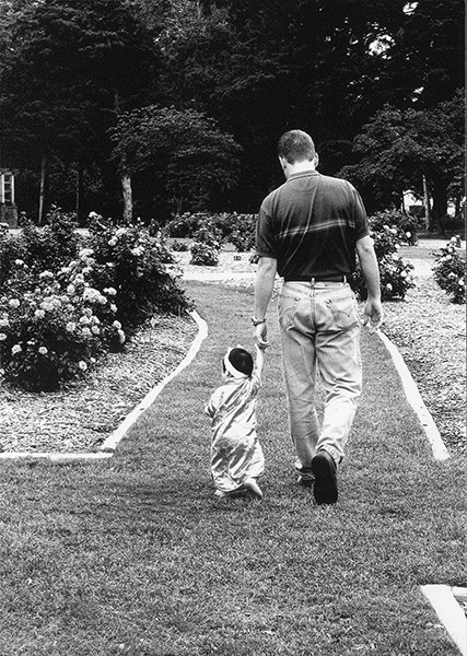 Steve Green walks in a garden with his daughter, shortly after adopting her. Photo courtesy of Green family