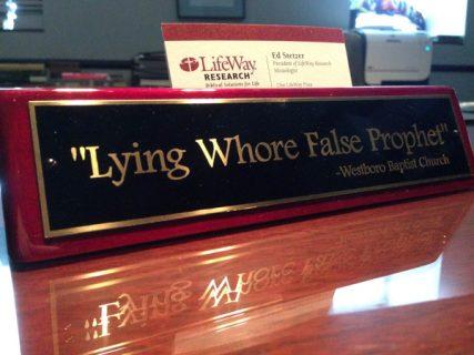"Ed Stetzer's desk sign reads, ""Lying Whore False Prophet. - Westboro Baptist Church."" Photo courtesy of LifeWay Research"