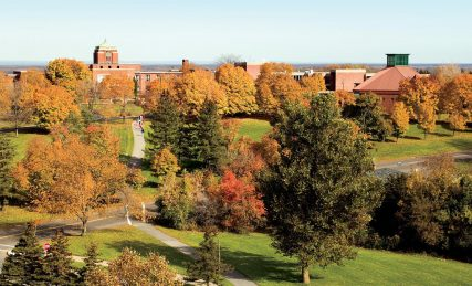 A view of LeMoyne College in the fall. Grewen Hall, with the dome, is at the left. The Jesuit college opened in 1946 in Syracuse, N.Y. Photo courtesy of Le Moyne College