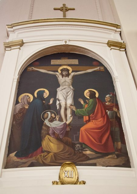 a61f5317 A painting of Jesus' crucifixion, part of a Stations of the Cross series,