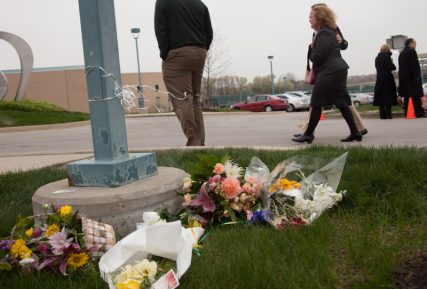 """Flowers mark campus grounds while members of the community enter the interfaith """"Service of Unity & Hope"""" to remember three shooting victims on Thursday (April 17) at the Jewish Community Center of Greater Kansas City in Overland Park, Kan. Religion News Service photo by Sally Morrow"""