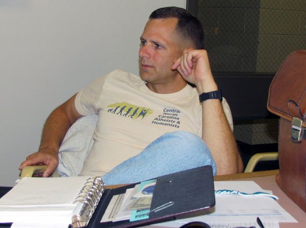 Ray Bradley listens during a planning meeting for the Central North Carolina Atheists and Humanists. Photo by John Nichols, courtesy of U.S. Army