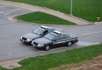 Two Overland Park Police cars patrol the Jewish Community Center on April 14 in Overland Park, Kan., one day after Fraizer Glenn Cross Jr., better known at F. Glenn Miller, shot and killed 2 men in the parking lot. Religion News Service photo by Sally Morrow
