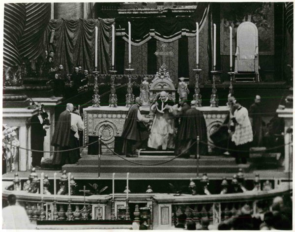 (1962) Pope John XXIII is shown at the main altar of St. Peter's Basilica in Rome at the close of the first session of the Second Vatican Council. He told the assembled Council Fathers they had made a