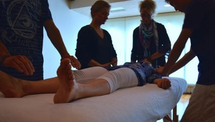 Reiki participants lightly touch down on the body to give positive energy. Photo courtesy of Brianna Sacks