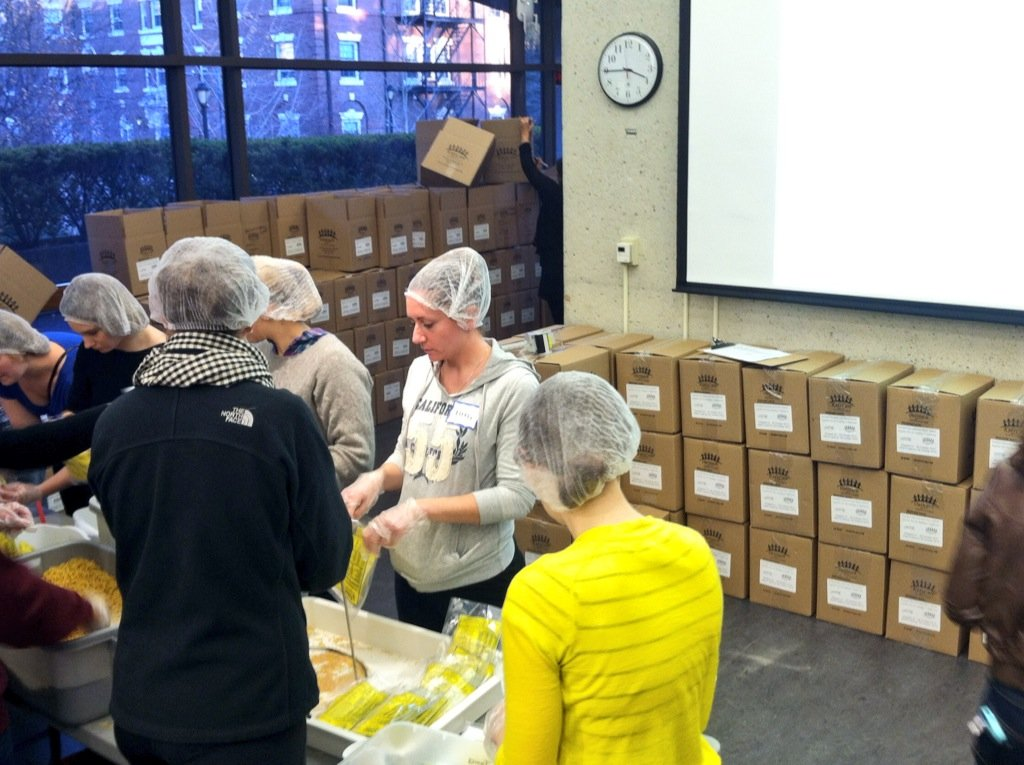 An interfaith meal packing and dialogue event at the Humanist Community at Harvard.