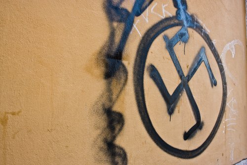 Swastika painted on a wall