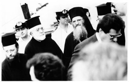 (1988) Archbishop Iakovos, second from left, of the Greek Orthodox Archdiocese of North and South America, accompanies the Ecumenical Patriarch of Constantinople, Demetrios I, as they make their way to the ship which carried them to Patmos, Turkey. Religion News Service file photo