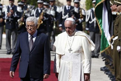Pope Francis reviews the honor guard with Palestinian President Mahmoud Abbas during an arrival ceremony at the presidential palace in Bethlehem, West Bank on May 25, 2014. Photo by Paul Haring, courtesy of Catholic News Service