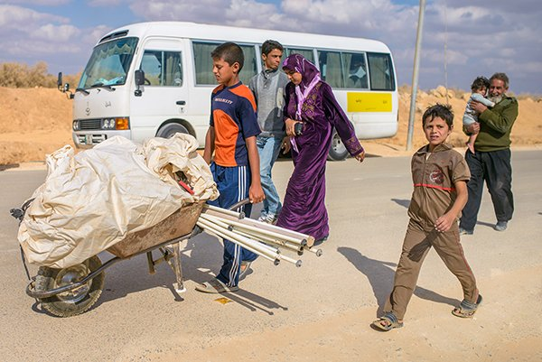 Syrian refugees in Za'atari camp in Jordan. The camp currently houses more than 80,000 refugees who have been forced to flee their homes due to the Syria conflict.