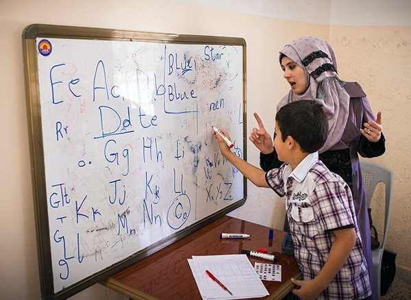 Syrian children participate in a World Vision remedial education program in Jordan. They are tutored in subjects like math, Arabic and English to help the catch up on the school they've missed fleeing the violence.