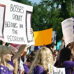 Protesters stand outside the Supreme Court on June 30, 2014, waiting for decision on the Hobby Lobby case. Some protesters had homemade signs, like this one. The Court later sided with the evangelical owners of Hobby Lobby Stores Inc., ruling 5-4 that the arts-and-crafts chain does not have to offer insurance for types of birth control that conflict with company owners' religious beliefs.
