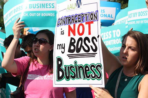 Demonstrators rallied at the Supreme Court on June 30, 2014 after the justices sided with the evangelical owners of Hobby Lobby Stores Inc., ruling 5-4 that the arts-and-crafts chain does not have to offer insurance for types of birth control that conflict with company owners' religious beliefs. After the decision, those who were disappointed continued to stand outside the Supreme Court. Religion News Service photo by Heather Adams