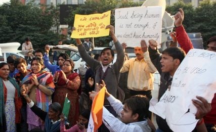 Protestors rally outside Sufdarjung Hospital in 2012 while seeking justice for a gang rape victim. Despite recent reform to toughen India's sexual violence laws, India's male-dominated and socially stratified culture isn't helping solve the problem, critics say.