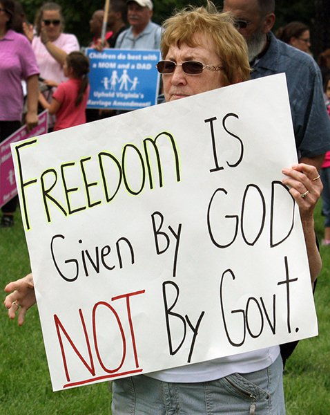 Cheryl Rupp brought a homemade sign to the March for Marriage event on June 19. She said allowing same-sex marriages would affect America's schools and economy.