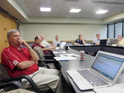 Charles Zech, in red shirt at left, listens along with deacons and seminarians in the Seminarian Leadership Institute started last summer by Zech, a professor of business at Villanova University and specialist in church management.