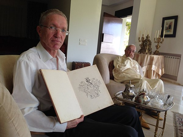 Hassan Bargach at his home in Rabat, Morocco on June 4, 2014, showing the book presented to his family by the Spanish government tracing its roots to the Iberian town of Hornachos. Photo by Gil Shefler