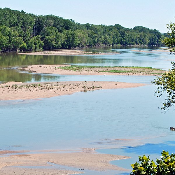 The Kansas River's water levels are being affected by sand and gravel dredging, according to the American Rivers organization.