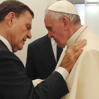 Kenneth Copeland prays with Pope Francis at the Vatican on June 24, 2014.
