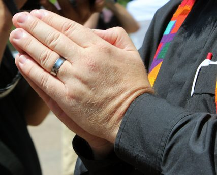 A protester clasps his hands in prayer during a march of religious leaders and immigration advocates towards the White House on July 31, 2014. They sought to halt deportations and aid immigrants living in the U.S. illegally.