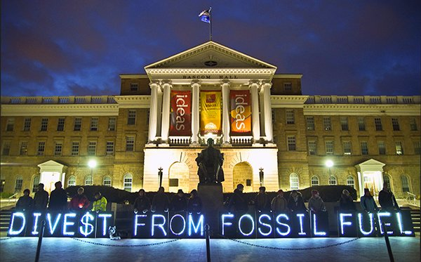 Activists support fossil fuel divestment in front of the University of Wisconsin-Madison's Bascom Hall on April 5, 2014. Fossil fuel divestment has gained support from a growing number of religious organizations, including Union Theological Seminary, World Council of Churches, the Unitarian Universalists and the United Church of Christ.