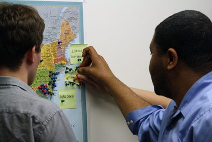 Secular Coalition for America intern Antonio Thomas, right, and other interns keep track of where the knitted bricks sent by people unhappy with the Supreme Court's Hobby Lobby decision are coming from.