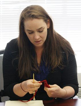 Secular Coalition for America Director of Operations Austin Cooper knits a brick in her Washington, D.C. office on July 17, 2014.