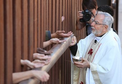 Cardinal Seán O'Malley of Boston and 7 other bishops celebrate Mass on the US-Mexico border in Arizona to commemorate the deaths of migrants in the desert and to pray for immigration reform on April 1, 2014.