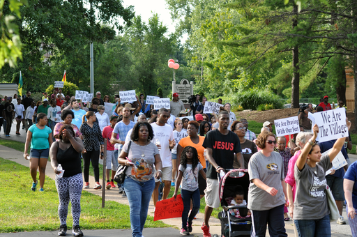People gather to march in Ferguson, Mo. on Aug. 15, 2014.