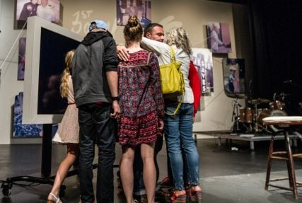Mark Driscoll was embraced by his family after Sunday's announcement. Photo courtesy of Mars Hill Church