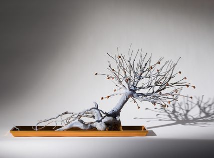 """""""Dwarfed Blue Pine,"""" by Rona Pondick, is a painted bronze sculpture that is being exhibited in """"Back to Eden: Contemporary Artists Wander the Garden"""" at New York's Museum of Biblical Art."""