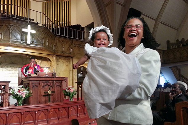 The Rev. Leslie Callahan, pastor of Philadelphia's St. Paul's Baptist Church, holds her daughter Bella at the child's dedication.