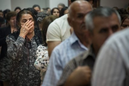 A Chaldean Catholic woman holds a rosary during a mass at Saint Joseph's Chaldean Catholic Church in the Ankawa neighborhood of Erbil, Iraqi Kurdistan on June 27, 2014. Many Iraqi Christians have fled to Erbil from other parts of the country because of violence from Muslim extremists.