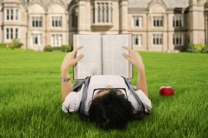 A female college student reading a book.