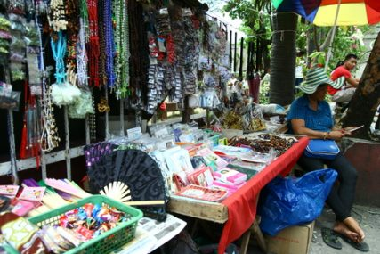 A vendor sells religious items outside a Catholic church during Good Friday (April 18, 2014) in Cainta, Philippines.