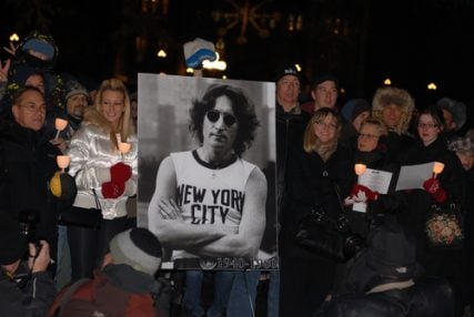 "Fans gather at the centennial flame to sing ""Give Peace a Chance"" on the 30th anniversary of John Lennon's assassination on Dec 8, 2010 in Ottawa, Ontario."