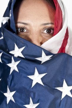 Woman with an American flag wrapped around her head.