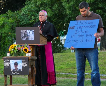 Bishop of Manchester, Peter Anthony Libasci, speaks during a vigil on Saturday (Aug.23) for slain journalist James Foley at the Rochester Commons in Rochester, N.H. Photo by Shawn St.Hilaire / Democrat Photo