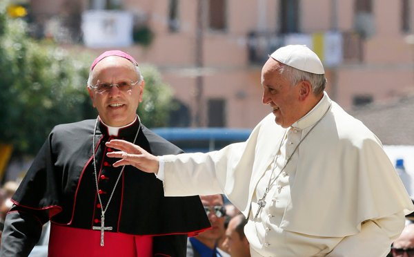 Pope Francis greets people as he visits Cassano allo Ionio, in Italy's Calabria region, June 21, 2014. On his left is Bishop Nunzio Galantino of Cassano allo Ionio. Photo by Paul Haring, courtesy of Catholic New Service