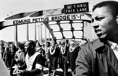 Pastors, priests and rabbis joined Dr. Martin Luther King, Jr., (center) in the 1965 march on Selma. Now, clergy are joining protesters demanding justice in Ferguson, MO. Religion News Service file photo by Robie Ray