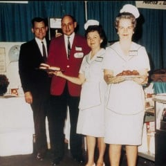 Truett Cathy (second from left) offering samples of the Original Chick-fil-A Chicken Sandwich. The company was known and even criticized for its charitable donations.