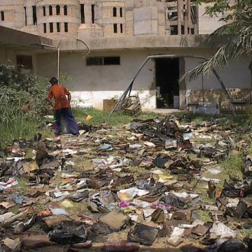 Workers attempted to dry the books and documents found in Iraq in 2003 by placing them outdoors. Photo courtesy of Harold Rhode via US National Archives and Records Administration