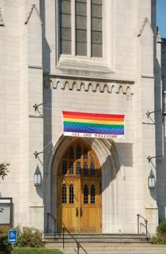 A church with a sign welcoming gay and lesbian members.